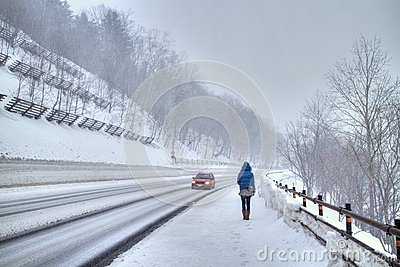 Walking in a snowstorm Editorial Stock Photo