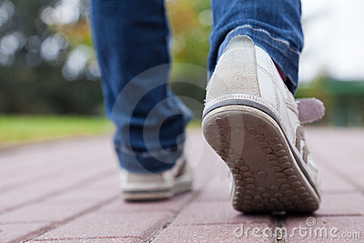 Walking in sport shoes on pavement