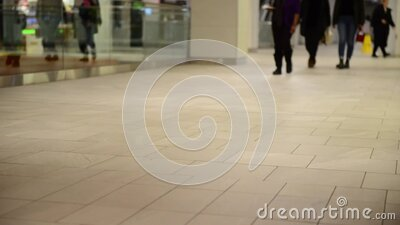 Walking thru a mall with lags showing stock footage