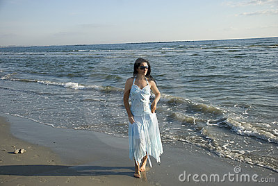 Walking woman on beach