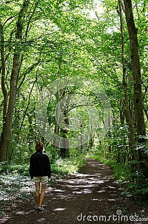 Walking woman in forest