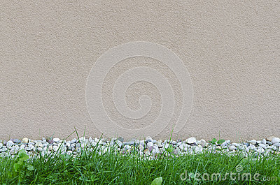 Wall background with rocks and grass