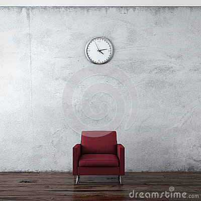 A wall clock and red chair