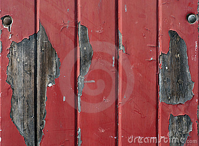 Wall with flaking red paint