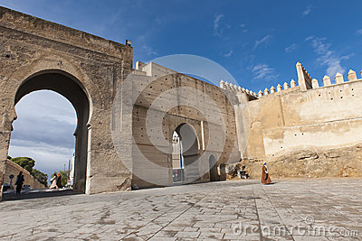 Old man in front of wall gate in Fes, Morocco Editorial Image