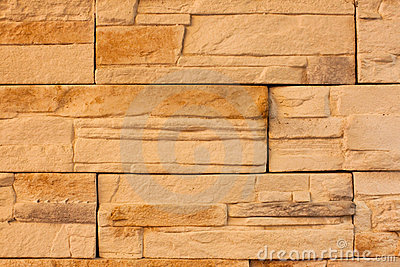 A wall made from yellow bricks