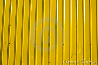 Wall made of yellow wooden planks.