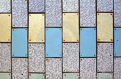Wall with old plastic tiles of various colors