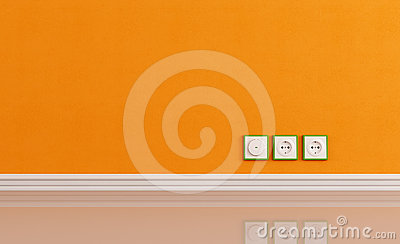 Wall outlets on the orange wall