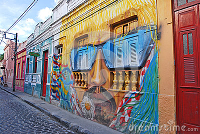 A wall painting of a man s head with moustache and sunglasses Editorial Photography