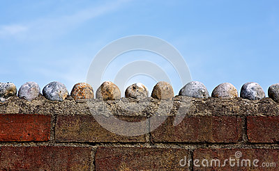Large  pebbles on a wall