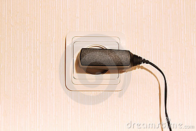 Wall plug with a cable