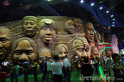 Wall of smiling faces in the Joint Africa Pavilion Editorial Photography