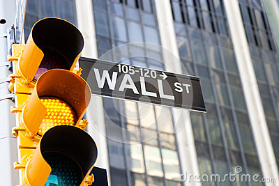 Wall Street Sign and yellow traffic light, New York