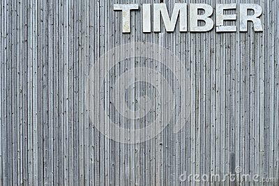Wall of timber with sign