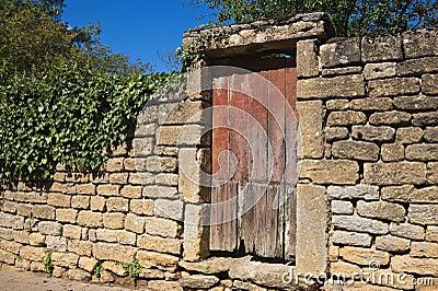 Wall and wooden door