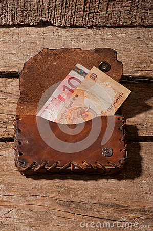 Wallet with banknotes of rupee and euro