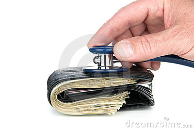 Wallet with cash eing examined with stethoscope.