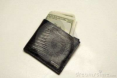 Wallet full of dollar bills