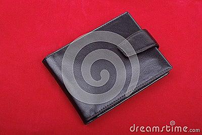 Wallet on red velvet.