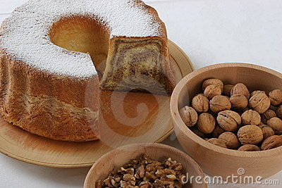 Walnut cake with piece cut off nuts