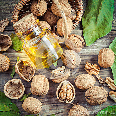 Free Walnuts, Bottle Of Nut Oil And Basket On Old Table Stock Image - 46405011