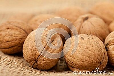 Walnuts laying on jute