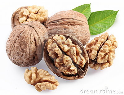 Walnuts with leaves.