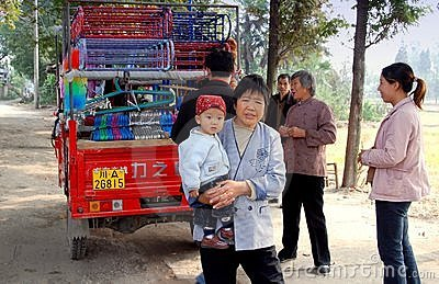 Wan Jia, China: Grandmother with Baby Editorial Stock Photo