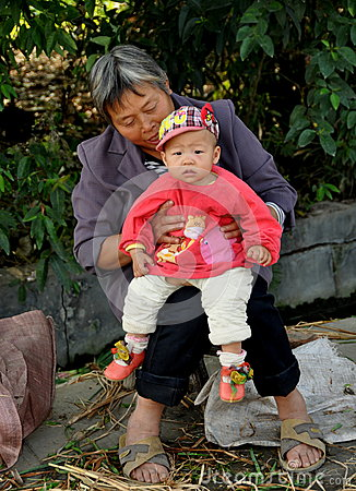 Wan Jia, China: Grandmother and Baby Editorial Photo