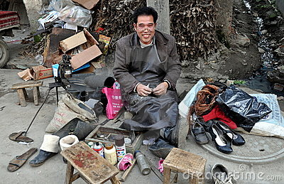 Wan Jia, China: Street Cobbler Editorial Photography