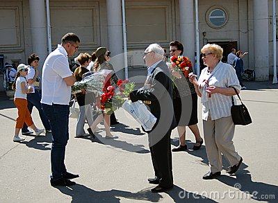 A war veteran receives flowers Editorial Stock Photo