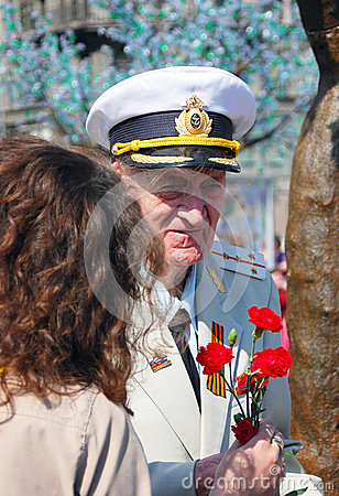 War veteran recieves flowers Editorial Image