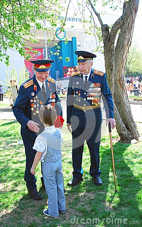 War veterans receive flowers Editorial Photography