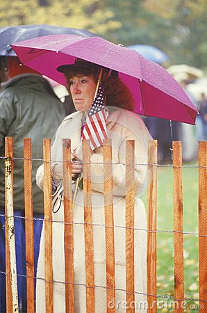 War Widow Holding American Flag Editorial Stock Photo