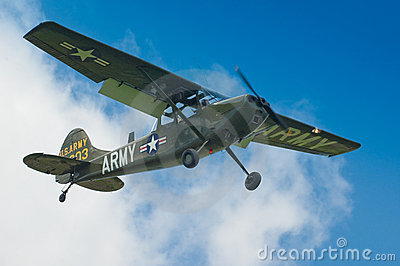 Warbirds - Bird Dog in flight Editorial Stock Image