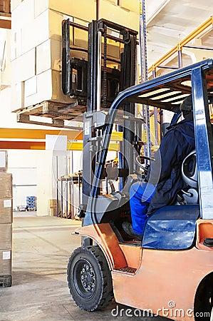 Free Warehouse Forklift Loader Work Stock Images - 12919324
