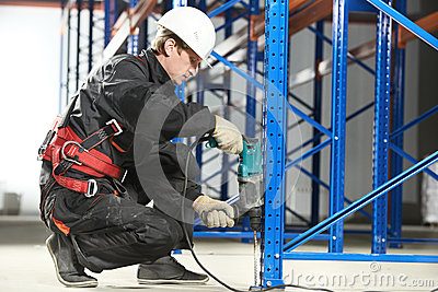 Warehouse worker installing rack arrangement