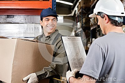 Warehouse Worker Looking At Supervisor With