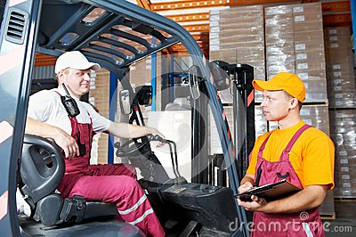 Warehouse workers in storehouse
