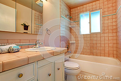 Warm bathroom interior in light peach