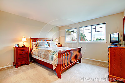 warm colors bedroom with wood furniture royalty free stock photo
