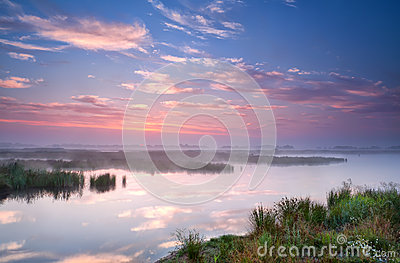 Warm summer sunrise over river