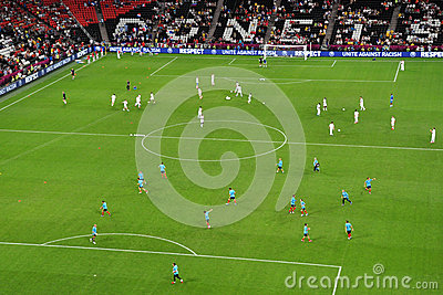 Warm-up teams of Spain and France on the field Editorial Stock Image