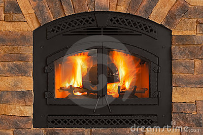 Warm Winter Fire with wood, flames, ash, embers and charcoal