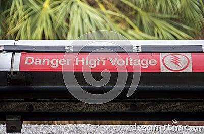Warning on high voltage on railway tracks