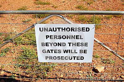 Warning sign on fence in Australia