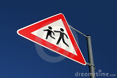 Warning sign with playing childs