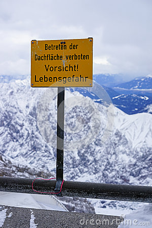 Warning sign on top of mountain