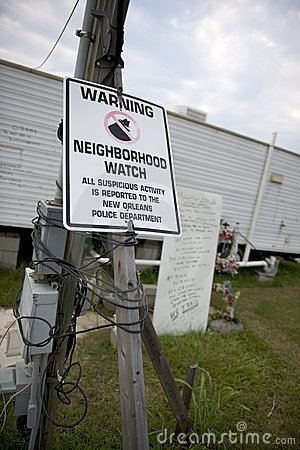 Warning sign in yard after Hurricane Katrina